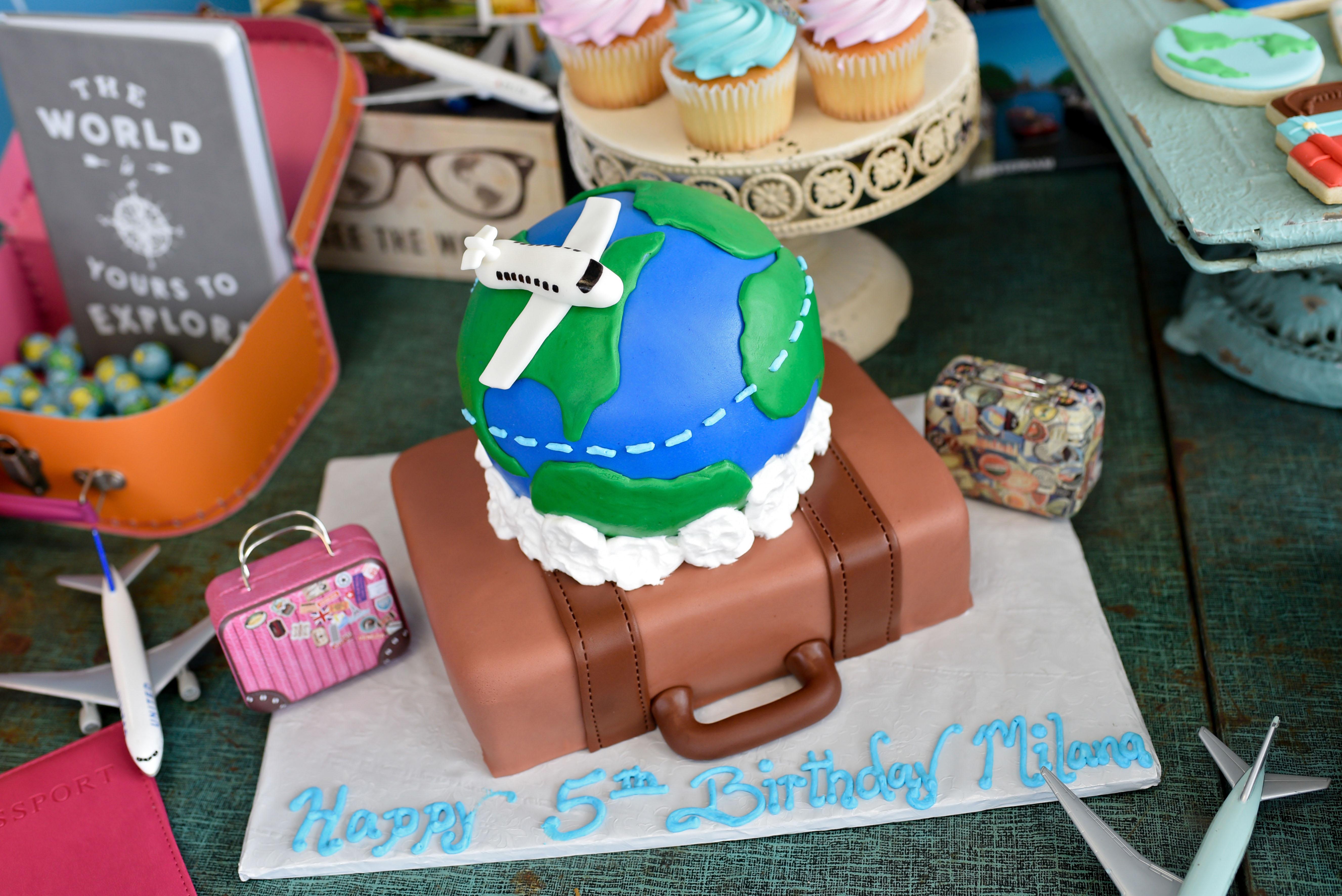 travel themed cake suitcase globe